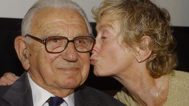 Sir Nicholas Winton as he gets a kiss on the cheek from Vera Gissingaged, 74, who as an 11-year-old was helped by Sir Nicholas to escape Prague before the Second World War