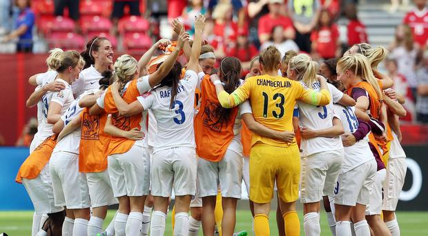 England celebrate victory after the final whistle of the quarter final match against Canada
