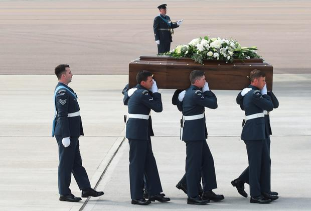 The coffin of Charles Evans, one of the victims of last Friday's terrorist attack, is taken from the C-17 aircraft at RAF Brize Norton
