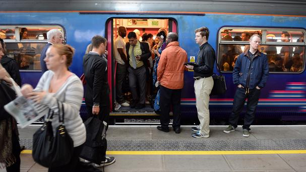 Commuters are spending more travel time doing online shopping, a report has said