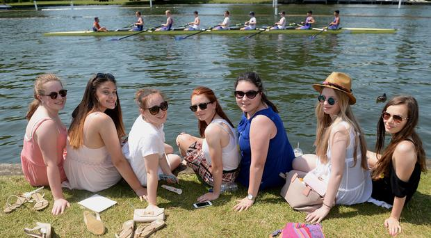A group of friends enjoy the hot weather at the Henley-on-Thames Regatta, Oxfordshire