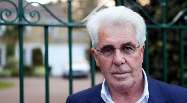 Max Clifford faces a charge of indecent assault