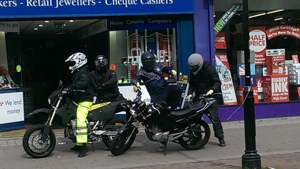 Photo taken by members of the public of offenders fleeing after robbing a jewellery store in Newport Street, Bolton.