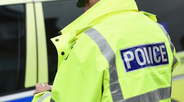 Two men riding bicycles robbed a woman in east Belfast