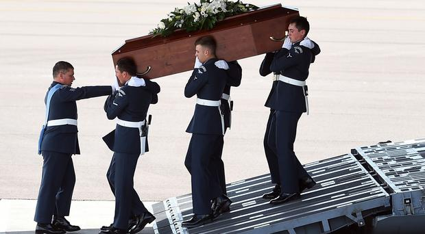The coffin of Claire Windass is carried from the RAF C-17 at RAF Brize Norton, one of the final five bodies returned