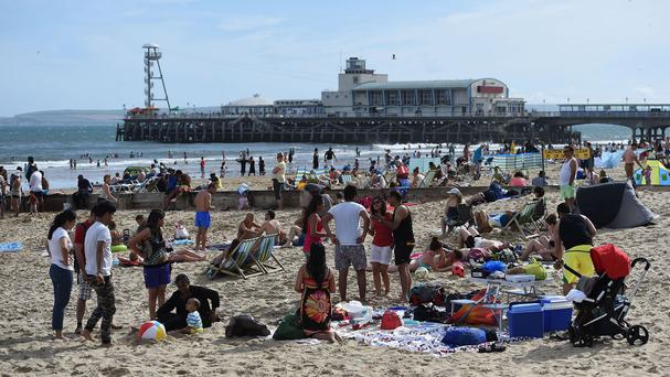 People bask on a packed Bournemouth Beach, Dorset