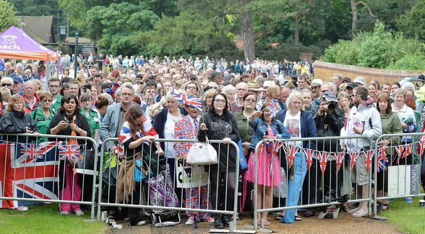 A large crowd of loyal royal fans near the area around the Church of St Mary Magdalene in Sandringham, Norfolk