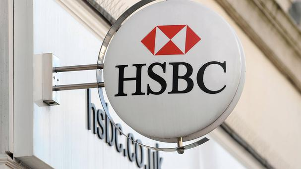 The HSBC workers were dressed in overalls and balaclavas at a go-karting centre when they reportedly staged a beheading scene