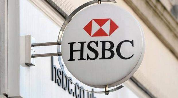 The HSBC workers were dressed in overalls and balaclavas at a go-karting centre when they reportedly staged a beheading scene.