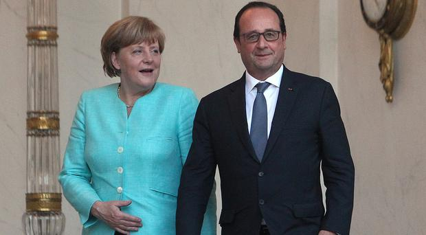 German chancellor Angela Merkel and French president Francois Hollande at talks over the Greece crisis (PA)