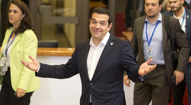 Greek prime minister Alexis Tsipras leaves after an emergency summit of eurozone heads of state or government in Brussels (AP)