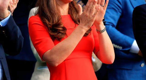 Catherine, Duchess of Cambridge enjoys the Centre Court action at Wimbledon yesterday as she watches from the royal box