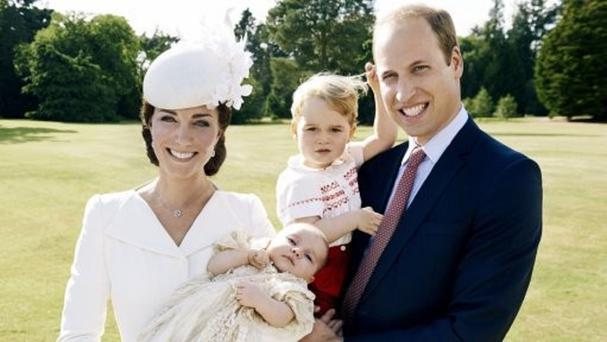 The Duke and Duchess of Cambridge and Princess Charlotte in a photograph taken by Mario Testino