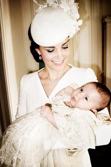 Kate cradles daughter Charlotte in her arms