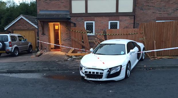 Damage caused to the home of Janet and Harold Perry in Suton Coldfield after Harry Bishop crashed his father's Audi R8