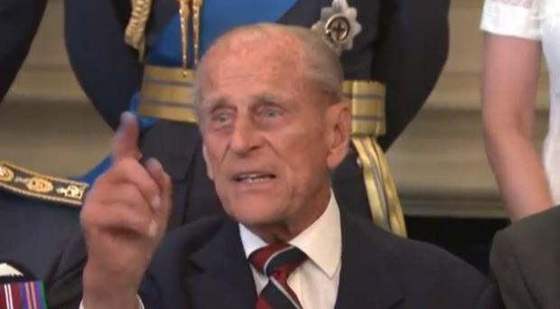 Philip, the Duke of Edinburgh impatiently waiting for the photograph to be taken