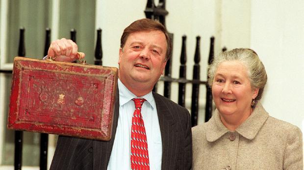 Chancellor Kenneth Clarke holds aloft the Budget Box in 2003, accompanied by his wife Gillian, who has died