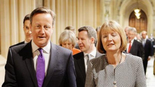 Prime Minister David Cameron and acting Labour party leader Harriet Harman.