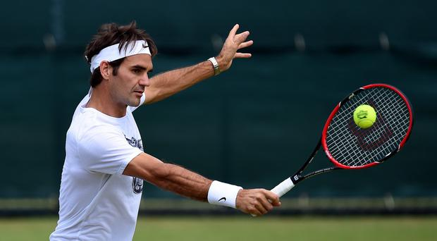 Roger Federer plays defending champion and number one seed Novak Djokovic in a repeat of last year's final on Centre Court