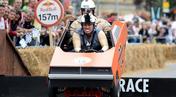 The winning team, The Breakfast Club, with driver Richie Firth and co-driver Christian O'Connell, take part in the Red Bull Soapbox Race at Alexandra Palace, London