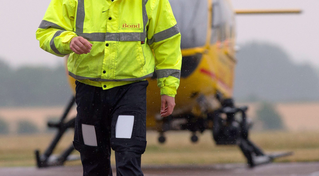 Prince William on his first day with the East Anglian Air Ambulance at Cambridge Airport yesterday