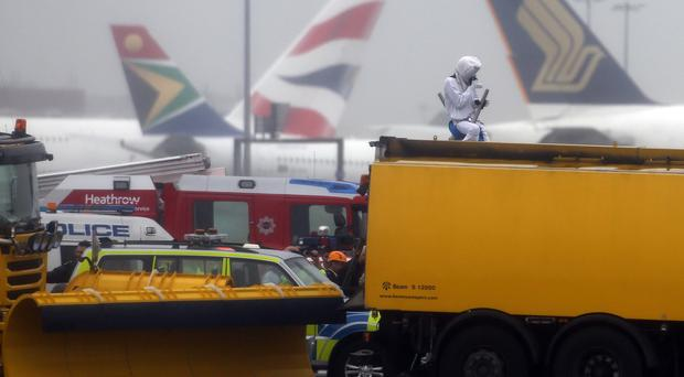 An activist dressed as a teddy bear was one of several demonstrators who occupied the north runway at Heathrow Airport
