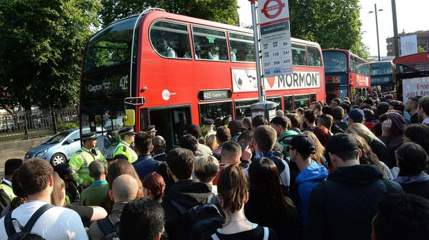 People queue for buses at Stratford station, London, during the recent Tube strike