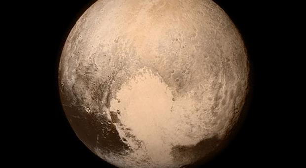 Photo issued by Nasa of the dwarf planet Pluto, captured from New Horizons (Nasa/PA)