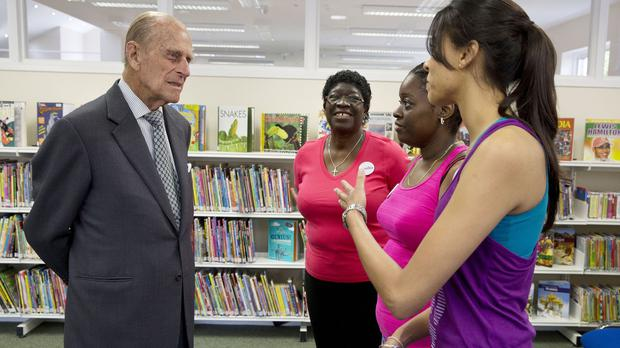 The Duke of Edinburgh talks to locals who took part in a Pilates demonstration during his and the Queen's visit to Chadwell Heath Community Centre