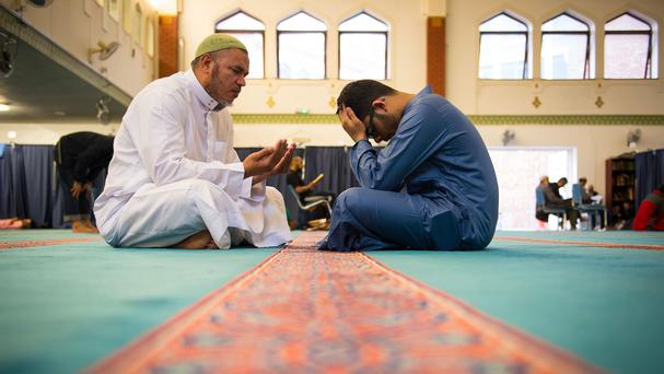Ahamad Ragab Eid, left, an imam from Egypt, practices his recital of the Koran with Omar Abdul Quayum at the East London Mosque in Whitechapel, London