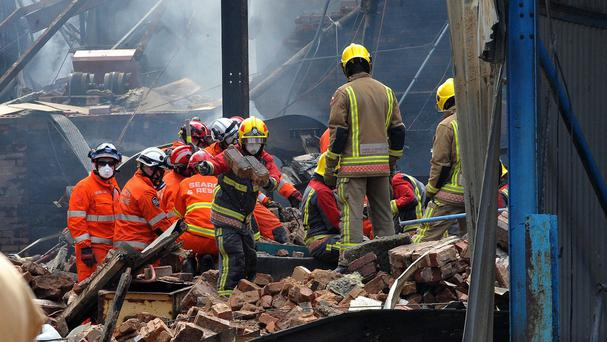 Search and rescue teams at the scene of the blast in Bosley, Cheshire