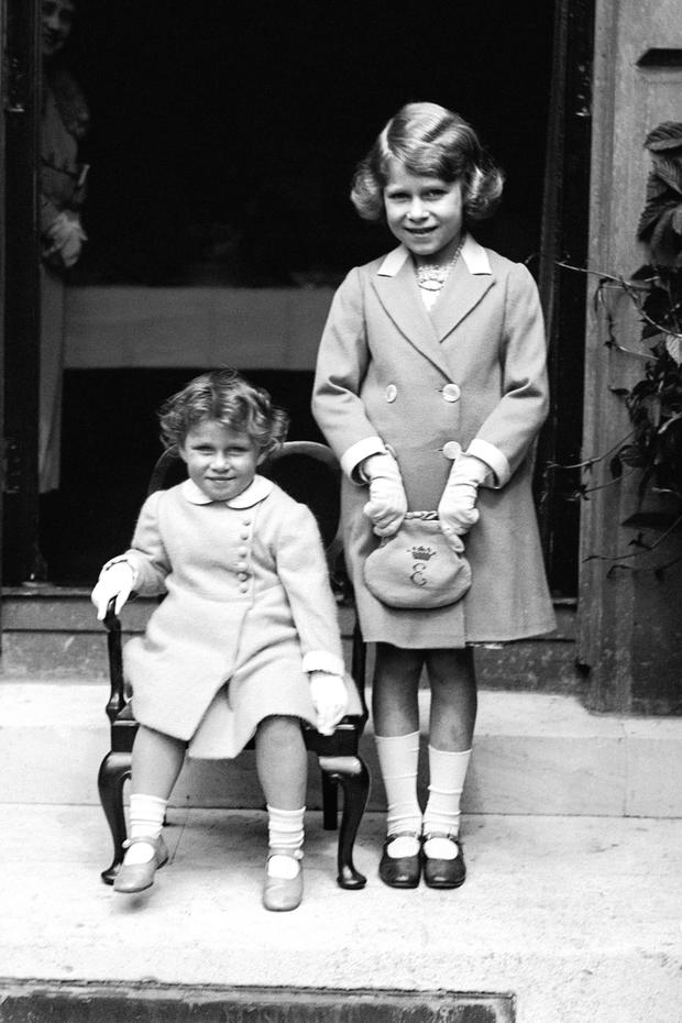 Princess Margaret (seated) with her sister Princess Elizabeth in 1933