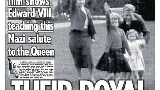 Handout photo taken from the Twitter feed of @TheSun of The Sun front page showing a still of footage from 1933 that shows a young Queen performing a Nazi salute with her family at Balmoral