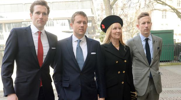 Sir David Frost's eldest son Miles (left) who has died while out jogging, with his brother Wilfred, mother Lady Carina Fitzalan-Howard and brother George