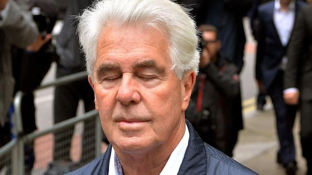 Max Clifford has been charged with indecent assault