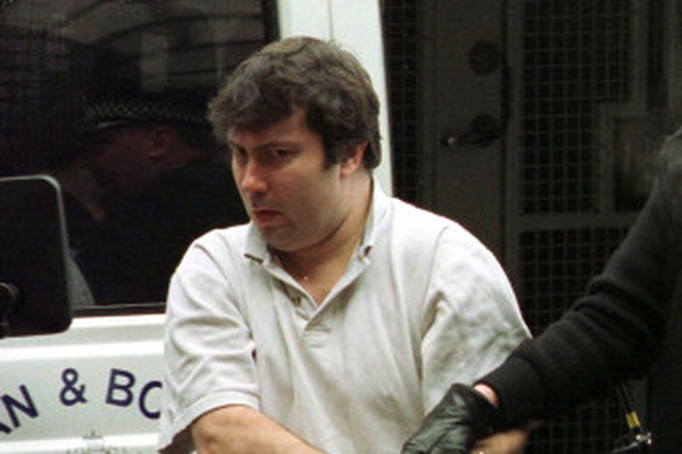 William Beggs in handcuffs after his horrific killing of an 18-year-old man