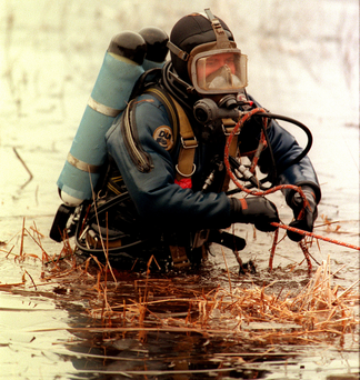 A diver trawls Loch Lomond for the remains of Beggs' victim Barry Wallace