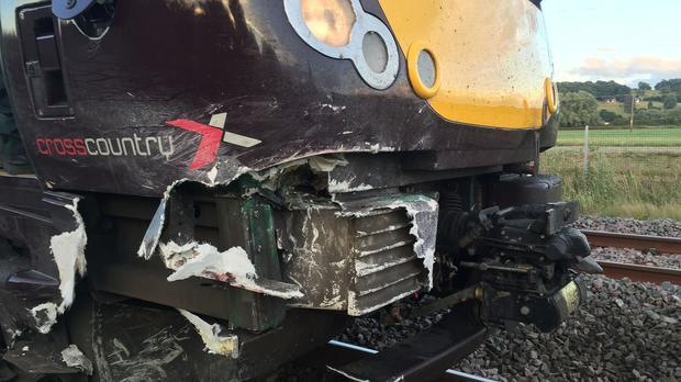 A train after it hit an empty car on a railway track in Staffordshire (@OFFICIALWMAS/PA)