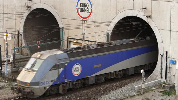 Eurotunnel have put up posters in Calais to warn migrants of the risks of hiding on the trains