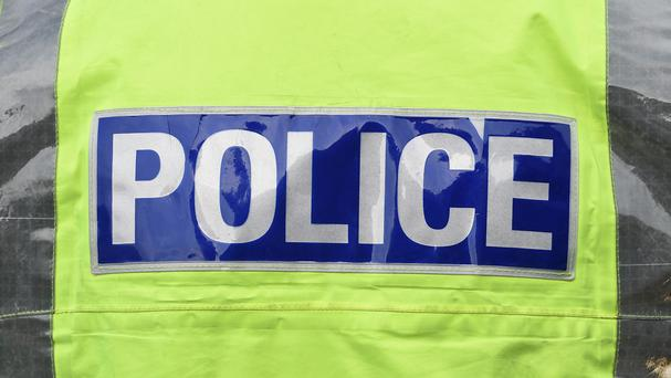 Police are seeking three men after a cash box was taken from a security guard