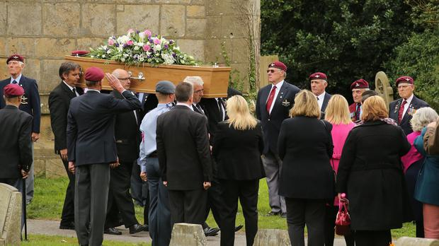 The coffin of Tunisian terror attack victim John Stollery is carried from St Edmund's Church after his funeral service in Walesby, Nottinghamshire