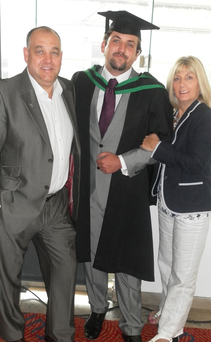 Jordan Kennedy at his graduation with dad Colin and mum Dawn