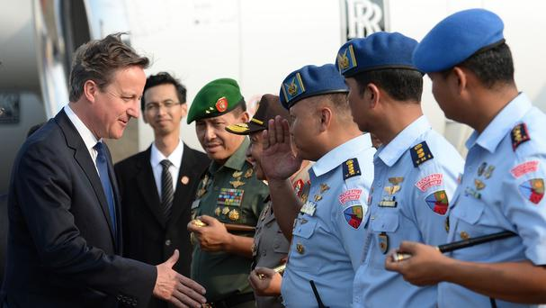 Prime Minister David Cameron (left) arrives in Jakarta, Indonesia, on the first day of a four day visit to south-east Asia