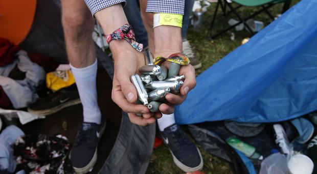 Discarded nitrous oxide canisters