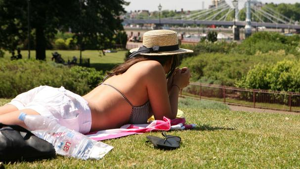 Health officials have issued new guidance for treating melanoma and also reminded people to cover up in the sun