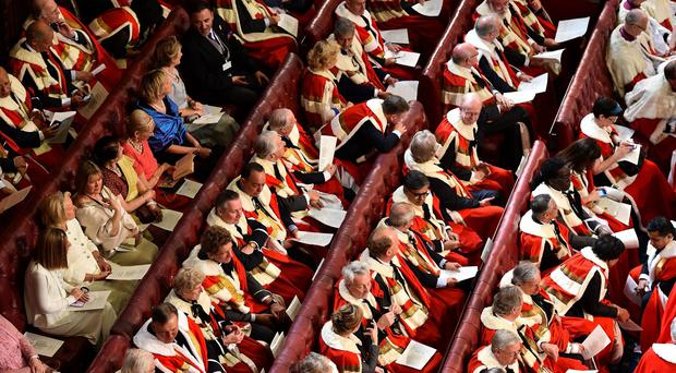 File photo dated 27/05/15 of peers and guests in the House of the Lords during the State Opening of Parliament