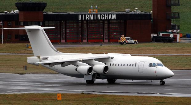 The woman was arrested at Birmingham Airport