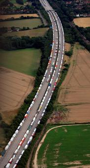Lorries queued as part of Operation Stack along the north and southbound carriageways of the M20 in Ashford, Kent