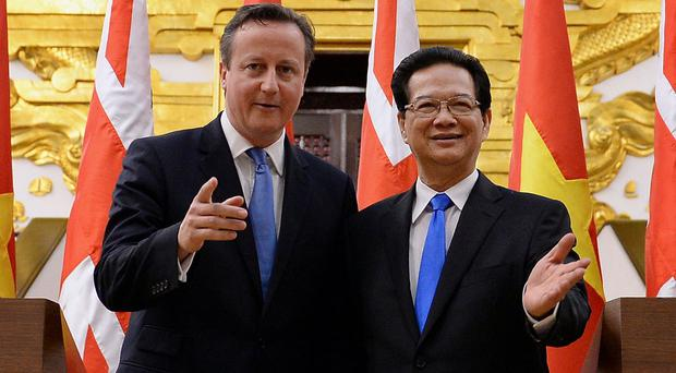 Prime Minister David Cameron holds a press conference with his Vietnamese counterpart