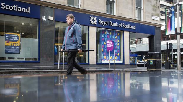 Royal Bank of Scotland took another 1.3 billion pound hit for banking scandal fines and warned of more charges to come